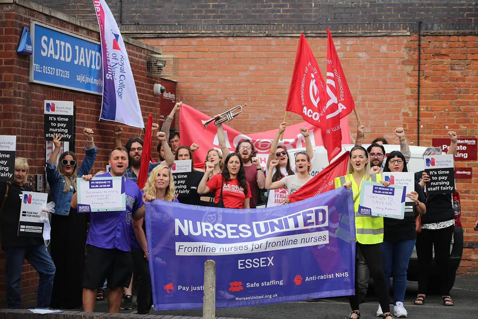Healthworkers and their supporters outside Sajid Javid's office